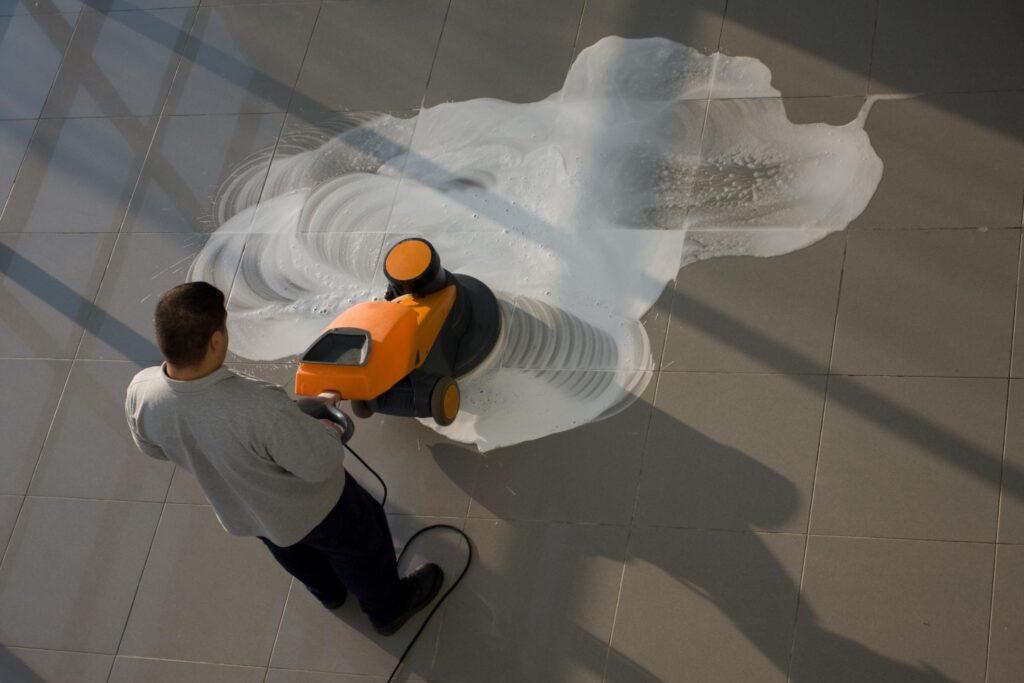 man polishing the floor
